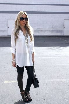 white long-line shirt with black leggings and cutout boots