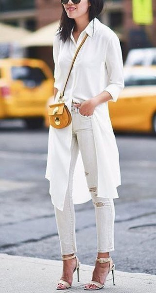 white knee length blouse with ripped ankle jeans