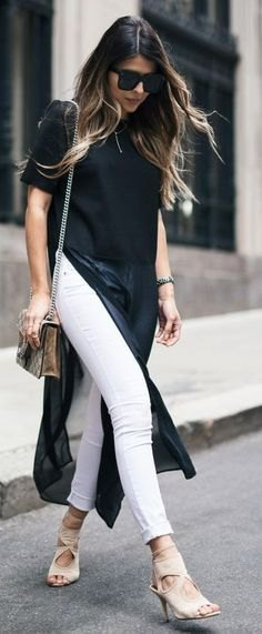 black maxi with high slit short sleeve blouse with white cuffed jeans