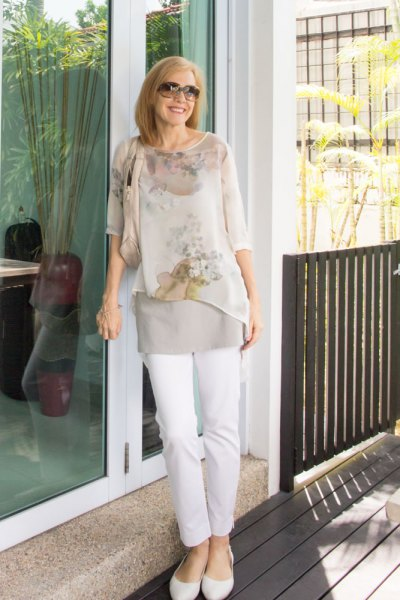 light pink floral printed chiffon blouse with white slim fit jeans