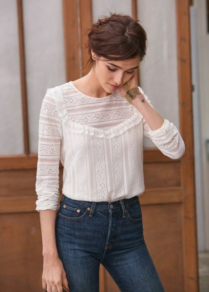 white patterned blouse with blue high-waisted slim jeans