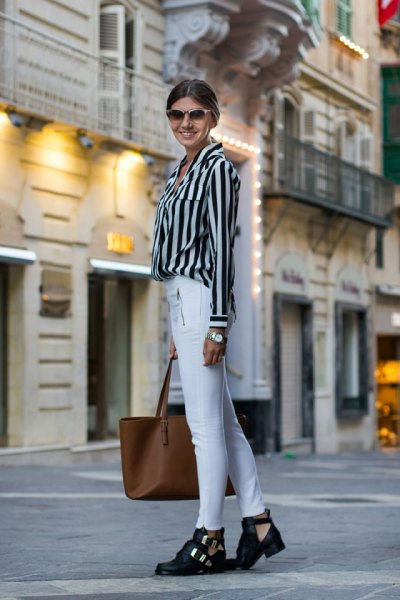 black and light gray striped button up shirt with white skinny jeans