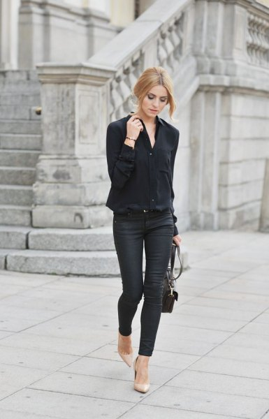 black oversized shirt with skinny jeans and pink lace-up heels