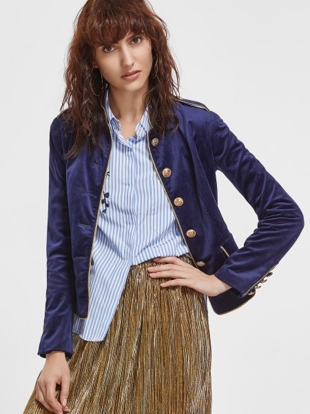 navy velvet sports jacket with striped shirt and pleated skirt