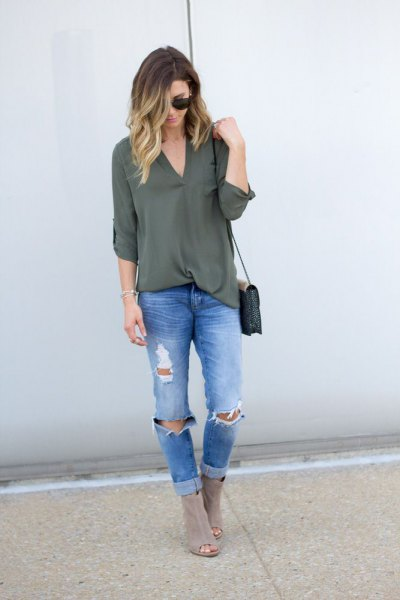 green chiffon with blue ripped slim fit jeans and gray boots