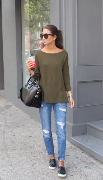 green boat neck blouse with blue ripped slim fit jeans