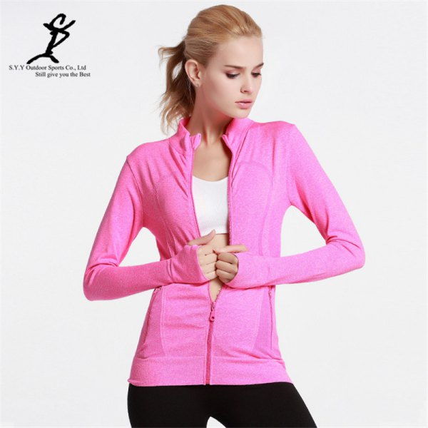 warm pink jacket with white sports bra top