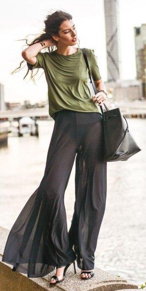green t-shirt with black chiffon watch pants