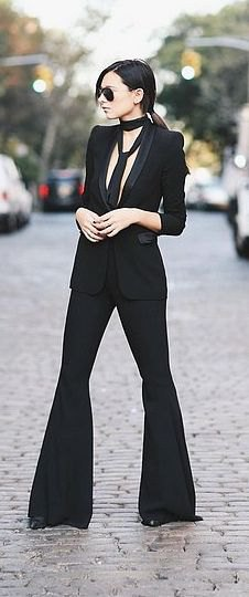 black blazer with bell bottoms and choker