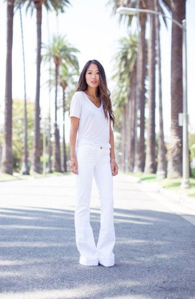 white v-neck tee with white bell bottom jeans