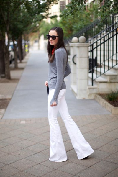 gray long sleeve fitted tee with white puffed jeans