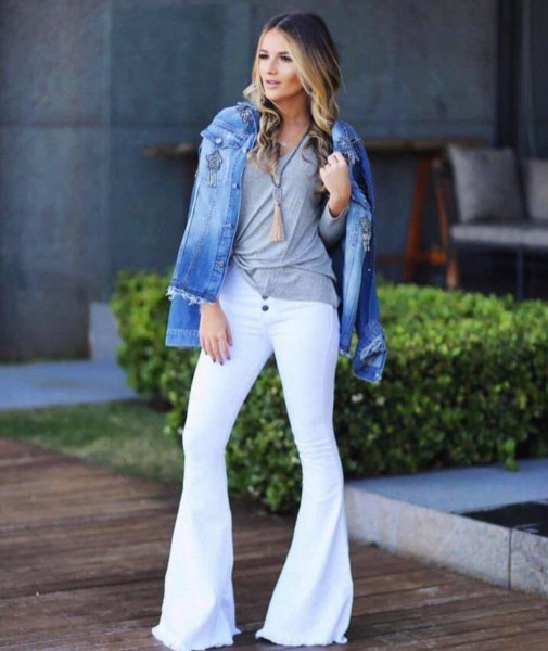blue denim jacket with gray t-shirt and white bell bottom jeans