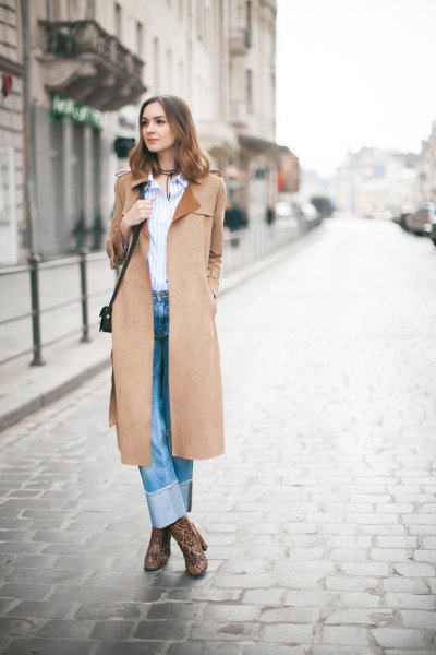 camel skirt with blue and white vertical striped shirt and cuffed jeans