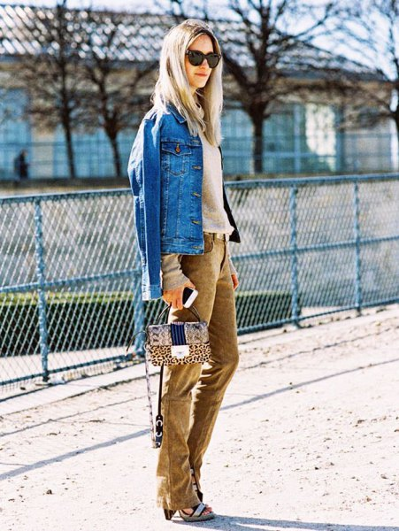 blue denim jacket with pink sweater and brown corduroy jeans
