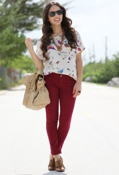 white floral printed short-sleeved blouse with red slim fit jeans