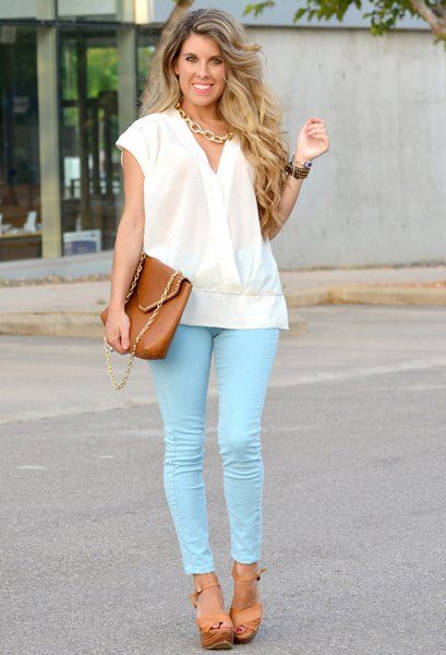 white hat with jacket with colored skinny jeans
