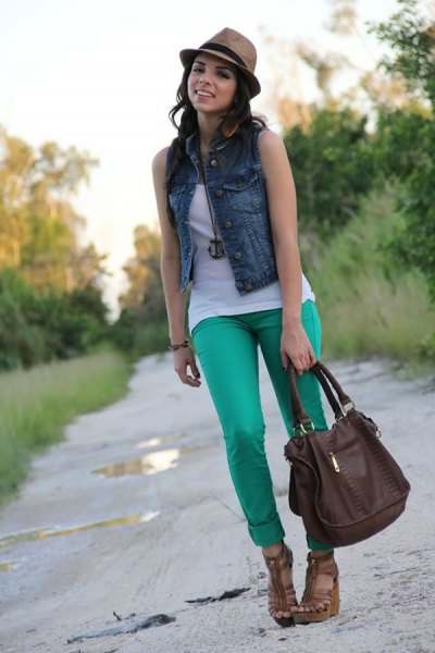 blue denim vest with light gray cuffed jeans