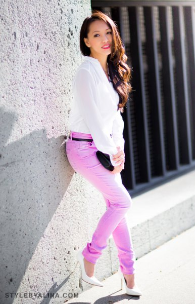 white chiffon blouse with colored belt in slim fit jeans