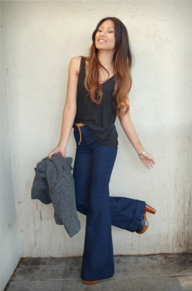 black tank top with navy blue high waist flared jeans