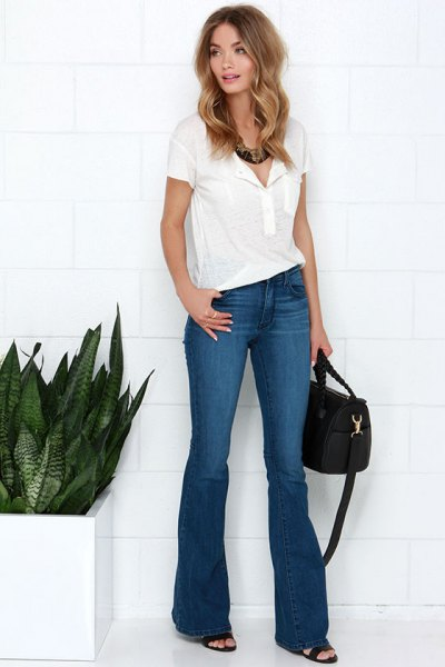 white polo shirt with blue puffed jeans and heels with open toe