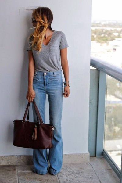 gray tee with bucket neck with light blue jeans