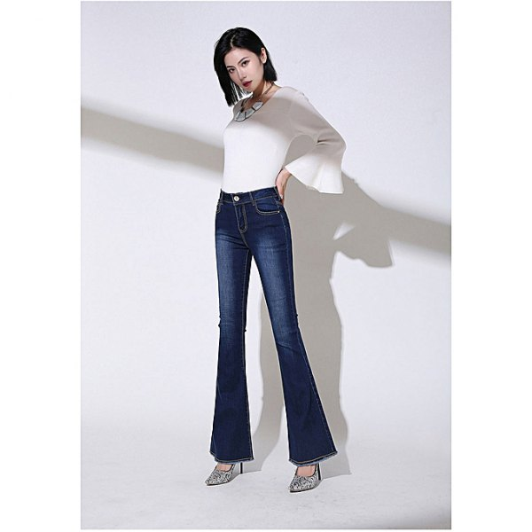 white watch sleeve top with dark blue high rise bell bottom jeans