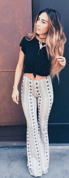 black knotted t-shirt with white tribal printed bell bottom yoga pants