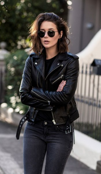 black moto leather jacket with dark jeans