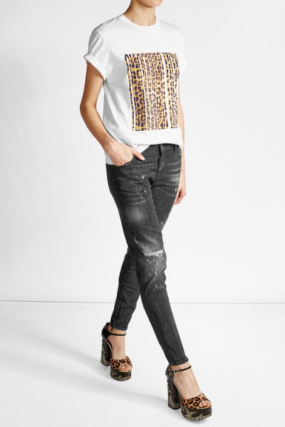 white print tee with black slim fit jeans