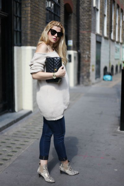 light pink an oversized knitted sweater with black cropped maternity jeans