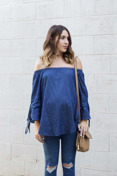 blue chambray of the blouse with ripped maternity jeans