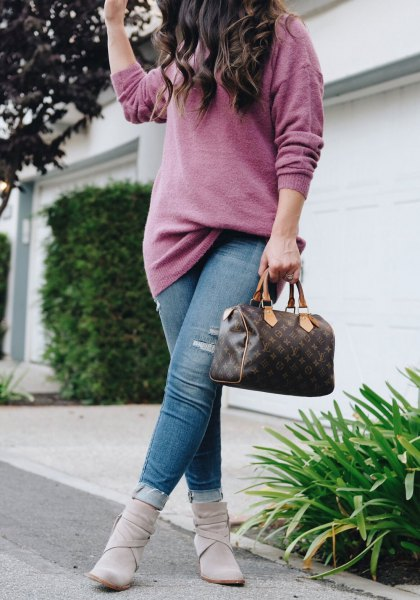 gray chunky knitted sweater with blue jeans and ankle boots
