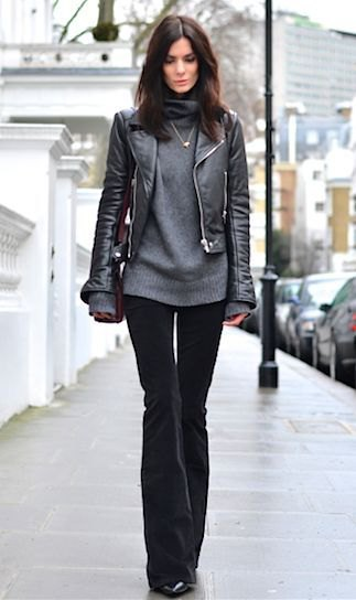 black fitted leather jacket with gray chunky sweater and flared velvet jeans