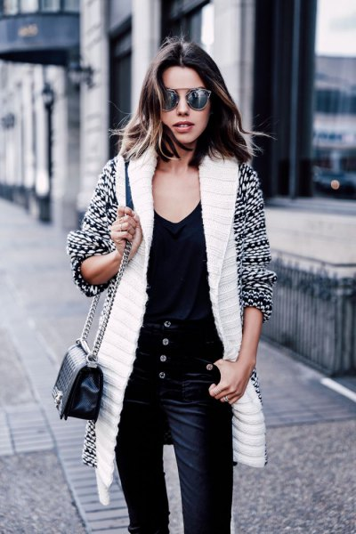 white and black printed long line sweater cardigan with velvet trousers