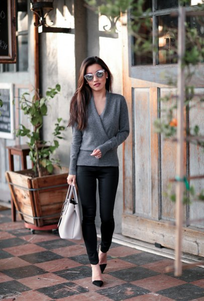 gray wrap sweater with black leggings