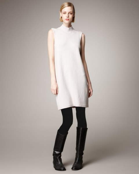 white mock neck sleeveless cashmere sweater with leggings and boots