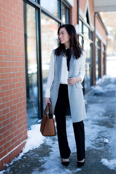gray wool long vest with white blouse and black chinos with straight legs