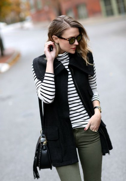black vest with striped long sleeve t-shirt and gray skinny jeans