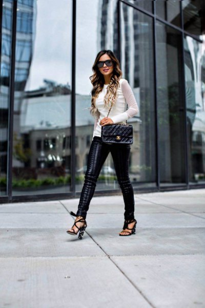 white fitted sweater with black lace trousers