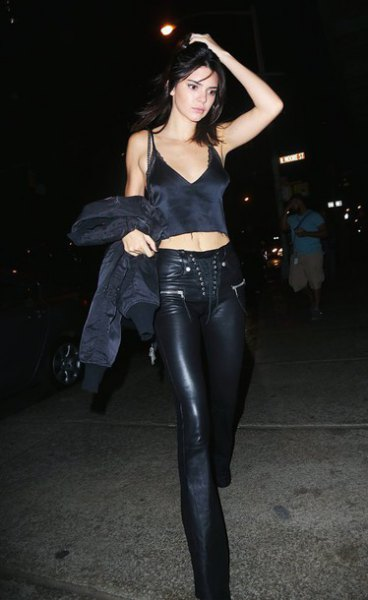 black deep v-neck camisole with flared leather pants