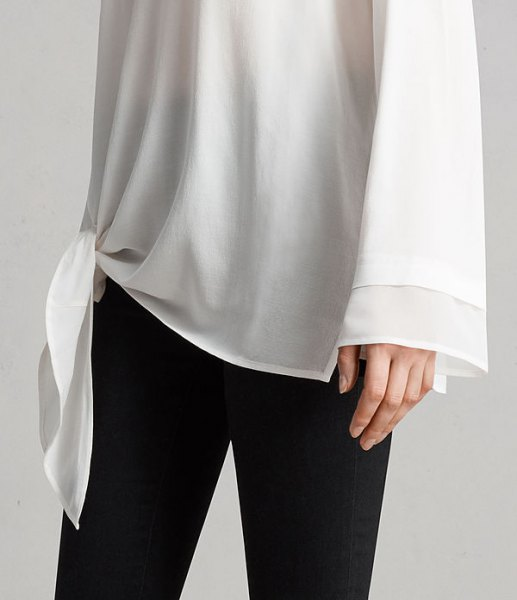 white knit long wide sleeve chiffon tunic shirt with black skinny jeans