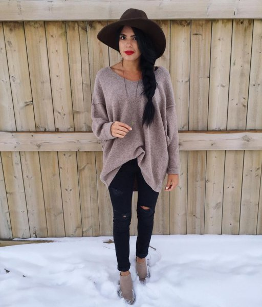 black floppy hat with gray big sweater and ripped black jeans