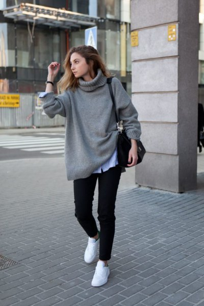 gray chunky sweater with light blue chambray shirt and white sneakers