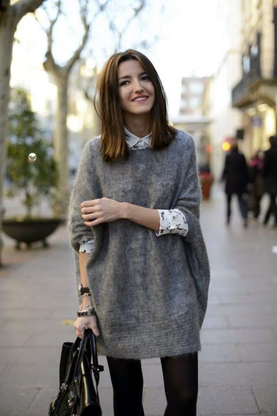 gray big sweater with white and black printed button up shirt