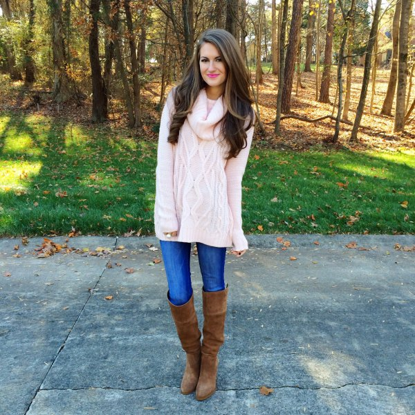 white cable knit chunky sweater with blue jeans and over the knee boots