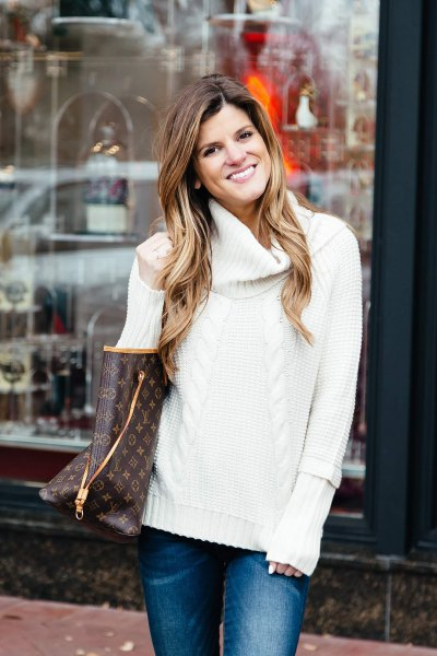 white knit sweater with blue slim fit jeans