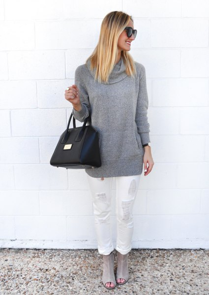 gray chunky sweater with white ripped jeans with straight legs