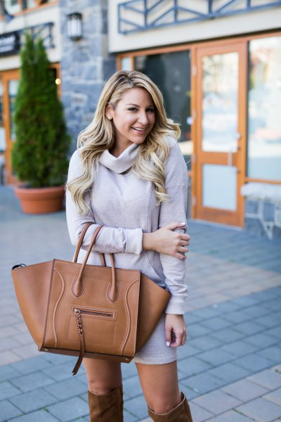 light gray sweater with knee neck with brown over the knee boots