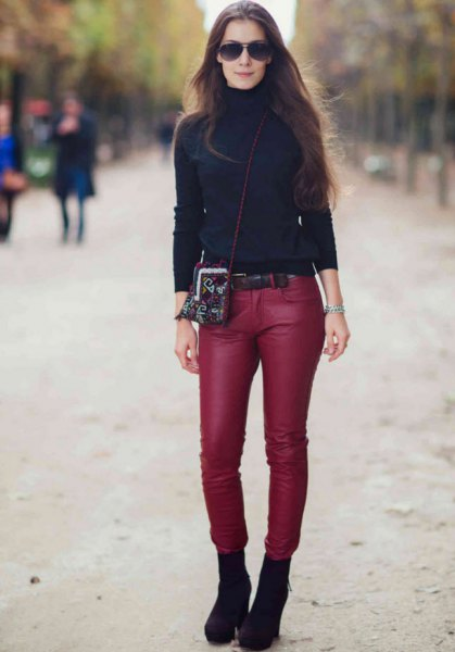 black turtleneck sweater with red skinny pants