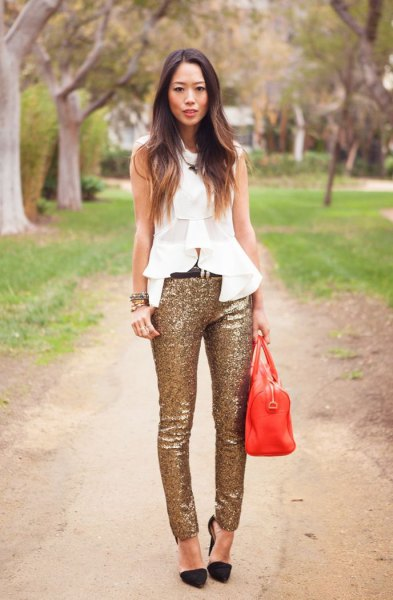 white sleeveless chiffon ruffle top with gold sequin skinny pants